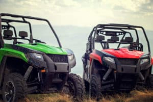 Green and red utility vehicles